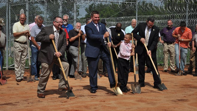 Grant Parish Sheriff Steven McCain, along with local pastors and community members, break ground for the Grant Parish Detention Center's new chapel on Tuesday.