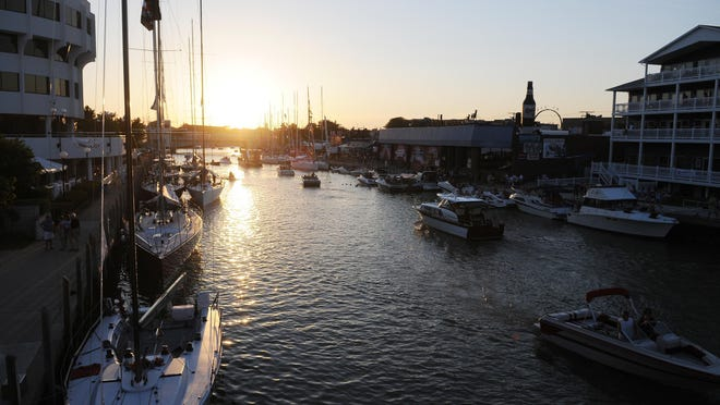 The sun sets on Family Night in 2011 on the Black River. This year's Boat Week is the biggest part of the year, as well as an all-class reunion.