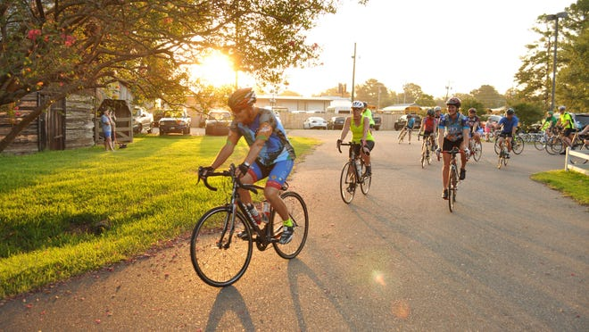 Paul Brand leads a group of cyclists training last Saturday morning for the Le Tour de Bayou's 30-mile ride.