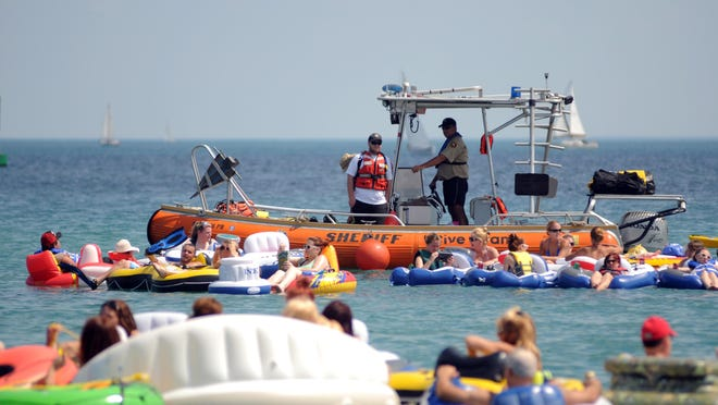 Members of the Sheriff Dive Team keep an eye Sunday  during the annual float down in the St. Clair River.