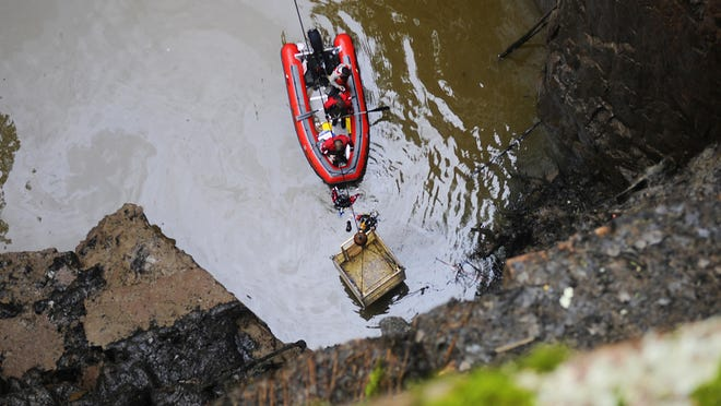 Stearns-Benton County divers Dave Bonfineld and David Patterson and a dive team prepare to be lifted up from Quarry 8 on Wednesday at Quarry Park & Nature Preserve after conducting a search of the quarry.