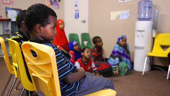 Kids gather in a classroom Friday at Hashiro Child Care.