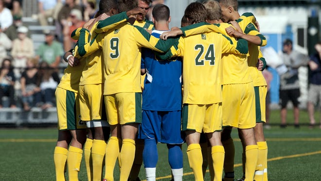 The Catamounts huddle together before the start of the men's soccer game against the Colgate Raiders at Virtue Field on Friday Sept. 6, 2013.