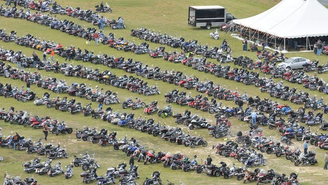 Thousands of motorcycles are parked on the grass at Arthur W. Perdue Stadium as riders participate in 2011 Bike Week.