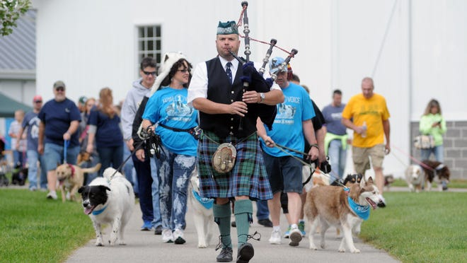 Piper, Kris Hunt, leads the march Sunday, Sept. 27, during the annual Mutt March at Goodells County Park.