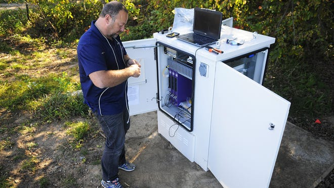 In this September 2015 file photo Monty Bettin, a central office technician, worked along the east side of Sauk Lake as part of a broadband project by Arvig. The company received funding help through the Minnesota state broadband grant program for the project.