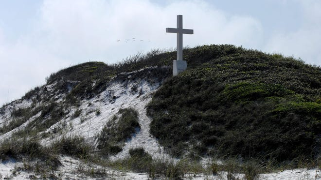 Pensacola Beach cross in April 2012. Development and hurricanes have nearly wiped away such dunes. Ben Twingley/btwingley@pnj.com Pensacola Beach Cross in April 2012. Coastal development and a series of hurricanes, dating back to Hurricane Frederic in 1979, have contributed to nearly wiping away many of the big dunes on Pensacola Beach.