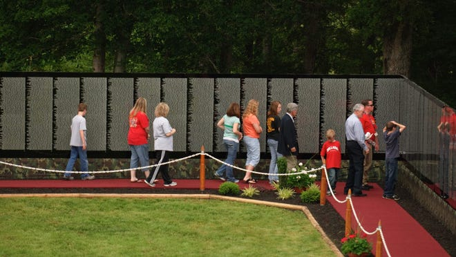 Visitors at The Moving Wall during its stop in Camden, Tennessee, in 2011. Photo courtesy of Vietnam Combat Veterans, Ltd.