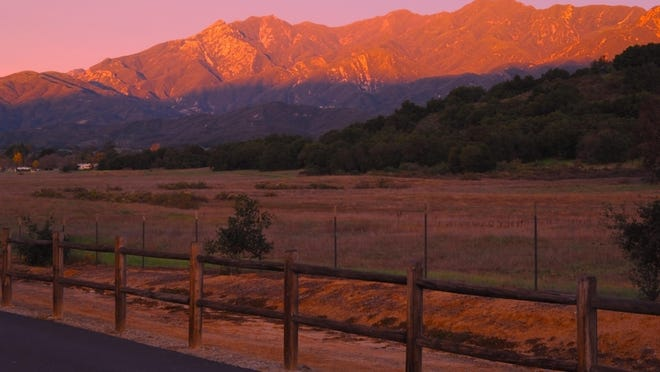 """When the sun dips behind the dramatic Topa Topa Mountains the embrace the town, the bucolic """"pink moment"""" is a celebration of the senses."""