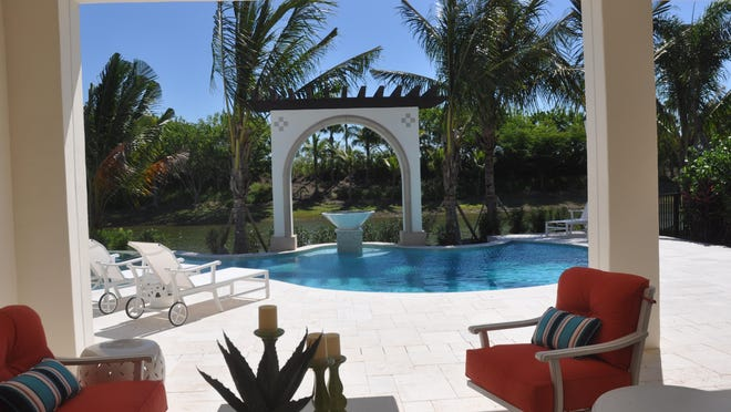 The Benita in Miromar Lakes Beach & Golf Club has unique architecture by the pool.