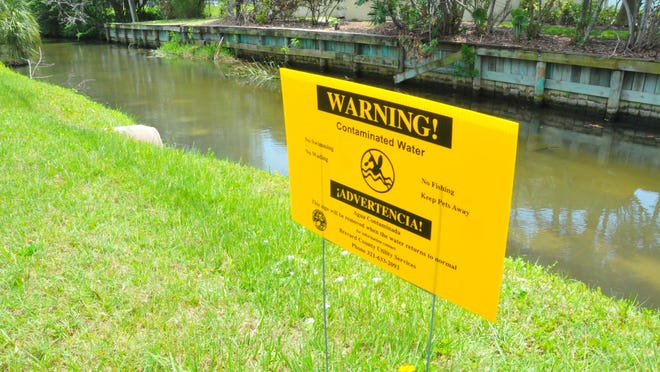 In a photo from May 2016, signs dot a canal by Anchor Drive east of South Patrick Drive, where a sewage spill into the lagoon took place.