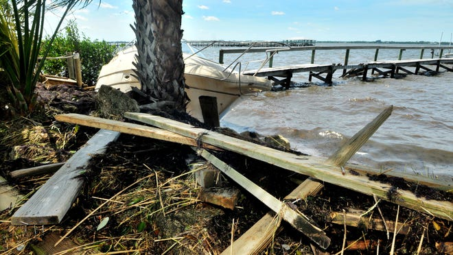 Boats and Debris washed ashore along the banks of the Indian River in Cocoa after Hurricane Matthew, which was packing 120 mph winds, with its storm surge destroying docks, seawalls and boardwalks in it's path .