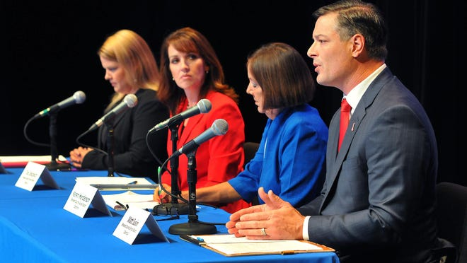 Brevard County School Board candidates Darcey Addo, Tina Descovich,Karen Henderson and Matt Susin addresses the crowd on the issues of Brevard County schools during Thursday nights candidate forum held at the Berard W. Simpkins Fine Arts Center on the campus of Eastern Florida State College .