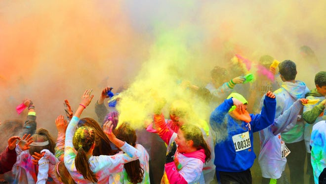 Following the First Annual Montville Township High School Color Run 5K race, students, parents, teachers, families, friends, teams and others gathered on the MTHS parking lot to participate in the Color Burst; a flourish of released Color Run powders.