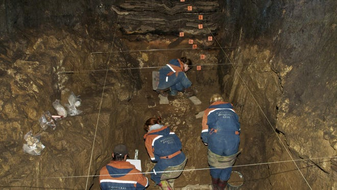 In this 2011 photo provided by Bence Viola of the University of Toronto, researchers excavate a cave for Denisovan fossils in the Altai Krai area of Russia. On Aug. 22, 2018, scientists reported in the journal Nature that they have found the remains of an ancient female whose mother was a Neanderthal and whose father belonged to another extinct group of human relatives known as Denisovans.