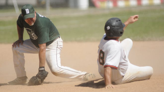 Buren Insurance Group's Shane Queer tries to tag All Season Patriots' Rick Sklodowski at second base during a USA Softball men's 50 and over tournament game on Saturday at Brookside Main. Ohio Battery won the tournament.