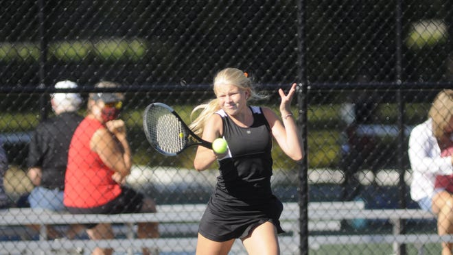 Ashland High School's Korinne Harris hits a shot during her first singles match at the Ashland Invitational on Saturday at Brookside Park. The Arrows won the title at the six-team invite.