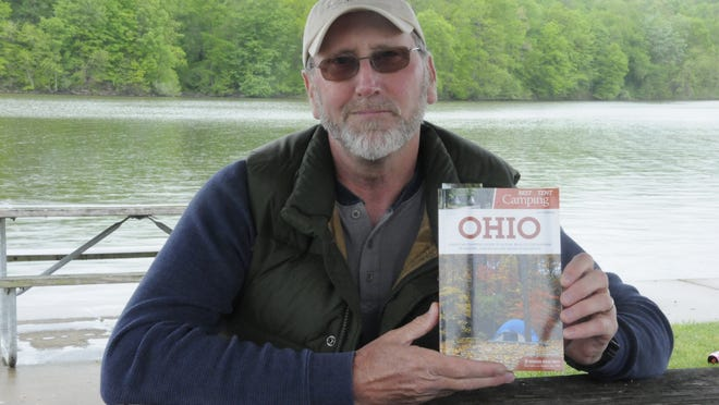 Author Robert Lowendick sits at the marina at Salt Fork Lake discussing his latest book 'Best Tent Camping, Ohio'.