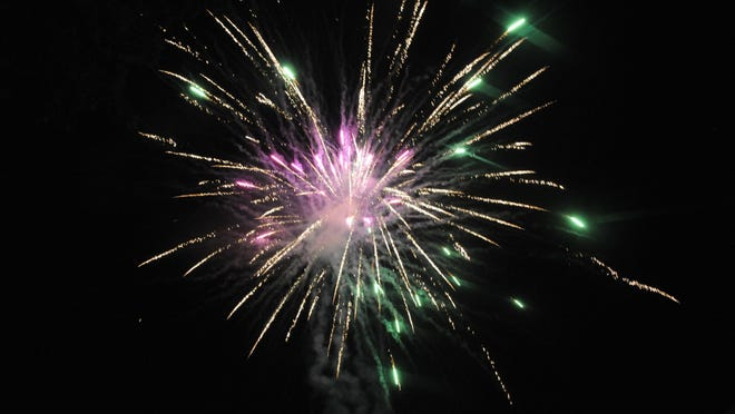 Fireworks that make shapes when they explode are hand packed into a sphere with stars that are shaped around a non metallic item that resembles a cookie cutter.