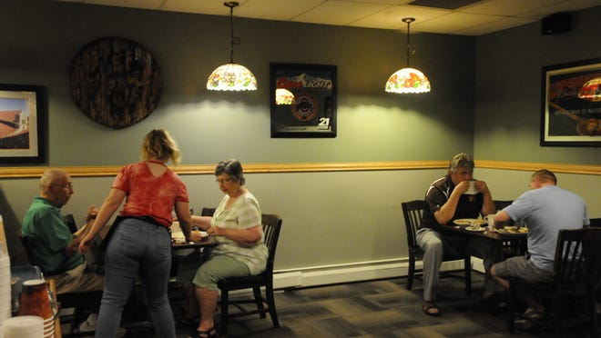 Customers at Francis Family Restaurant on Wheeling Avenue in Cambridge has breaskfast courtesy of Cambridge Iron and Metal on Saturday morning.