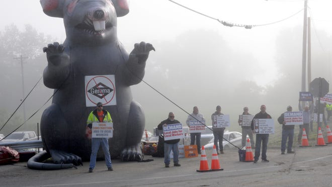 Local Laborers protest out of state workers at the Guernsey Power Station construction site in Byesville on Monday morning.