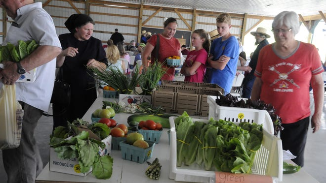 Peoli Farms Produce Auction gives buyers the opportunity to buy small quantities with a cash and carry table.