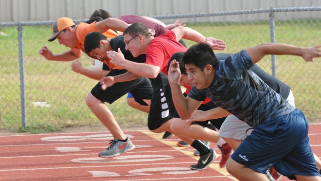 In this file photo, student-athletes take part in a dash during the Bastrop Strength and Conditioning Camp in 2016. The camp this summer was suspended after three students tested positive for COVID-19. Officials say the camp will resume Monday.