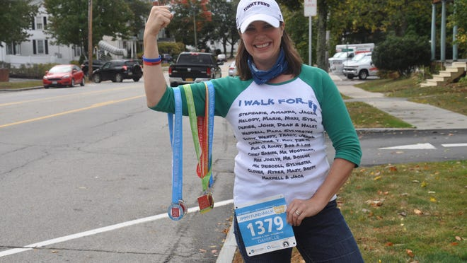 Danielle Mackey poses along a Dover portion of the Route 108 route she'll walk Oct. 4 as she participates remotely in the 32nd annual Boston Marathon Jimmy Fund Walk. Mackey, 41, a Rochester resident and Dover paralegal, is walking to honor the 31 people memorialized in name and picture on her race shirt.