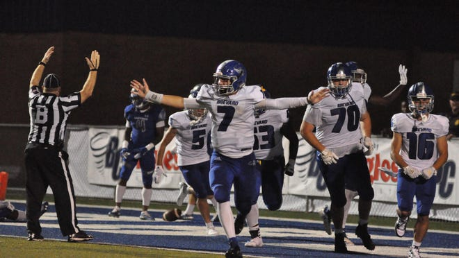 Brevard College sophomore quarterback Dalton Cole, a former West Henderson High standout, celebrates a late Tornado touchdown in a 27-6 victory over Christopher Newport last season at Brevard Memorial Stadium.