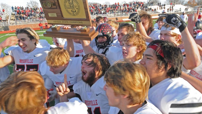 Rossville football players celebrate after receiving the class 2A state championship trophy after defeating Hoisington 27-20 at Salina Stadium on Friday afternoon.