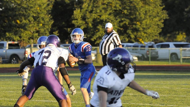 Lenawee Christian quarterback Landon Gallant looks to pass during a game against Athens in 2020.