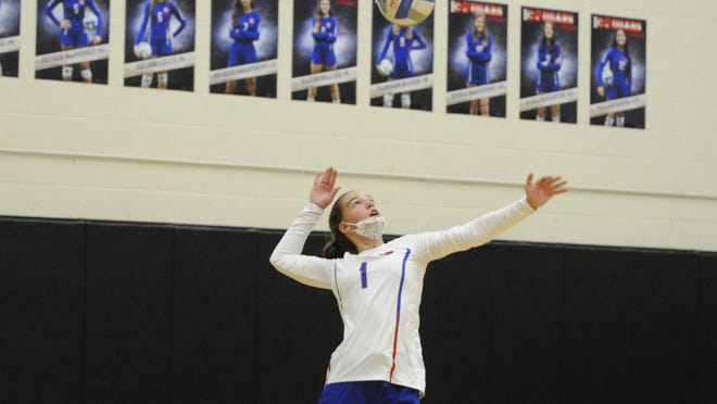 Lenawee Christian's Gabby Bryja serves during Thursday's match against North Adams Jerome.