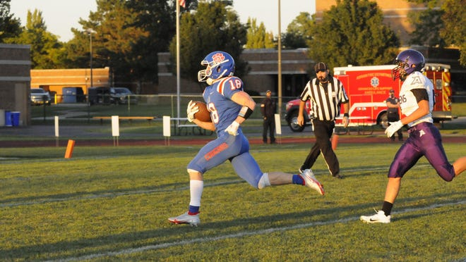 Lenawee Christian's Jameson Chesser runs the ball into the endzone during Friday's game against Athens.