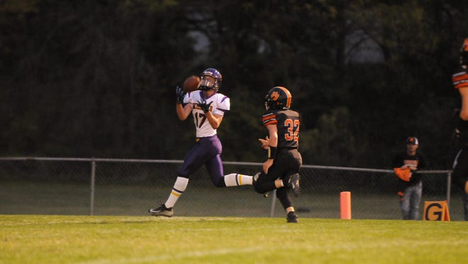 Blissfield's Owen Smith catches a touchdown pass during Friday's game at Hudson.