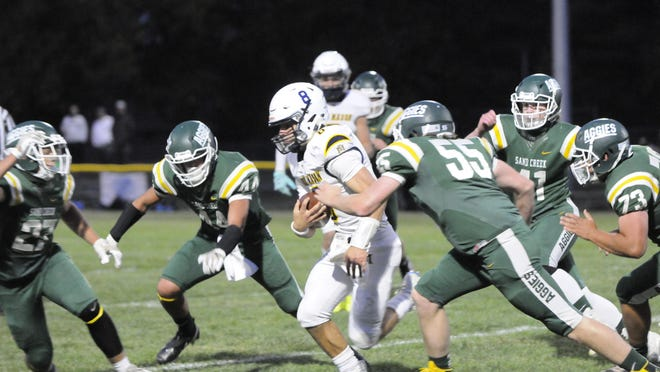 The Sand Creek defense surrounds Erie Mason's Noah Beaudrie during Friday's game.