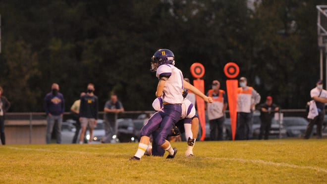 Blissfield's Aaron Stalker kicks an extra point during a game earlier in the 2020 season.