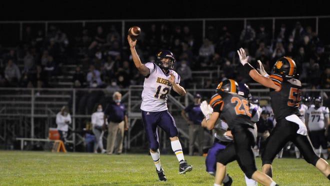 Blissfield quarterback Gavin Ganun throws a pass during a game against Hudson in 2020.