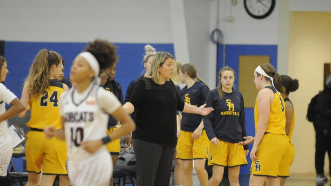 Siena Heights head coach Sue Syljebeck talks with Addyson Tomczak before a timeout during a game in the 2019-20 season.