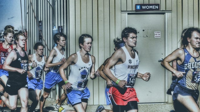 Adrian sophomore Aiden Smith runs during the Division 2 state finals meet at Michigan International Speedway on Nov. 7.