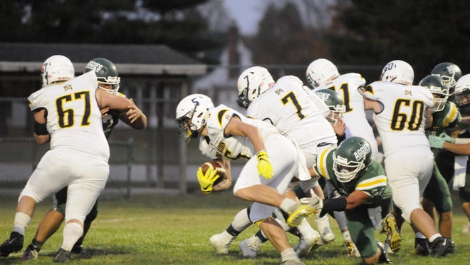 Erie Mason blockers Charles Micheau (67), Blake Hundey (7), Grant Hincher (71) and Matthew Null (60) clear a hole for Bryce Diehl against Sand Creek Friday night.