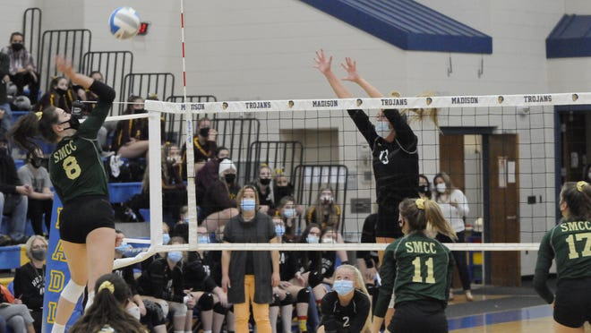 St. Mary Catholic Central's Mikayla Haut goes up for a kill while Hudson's Callie Bauer attempts to block during Tuesday's Division 3 regional Semifinal match at Adrian Madison.