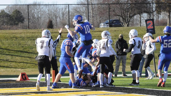 Lenawee Christian's Elliott Addleman jumps in the air after Jameson Chesser scores a touchdown against Martin in the Division 1 8-Man state semifinal game at Adrian College.