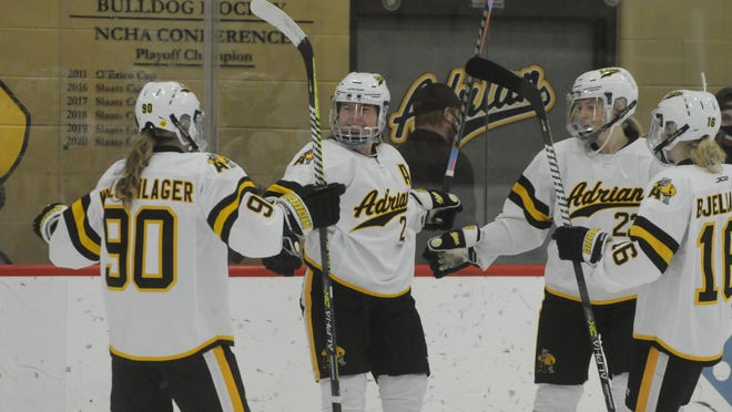 Adrian College's Callie Wollschlager (90), Jessica VonRuden (middle), Jessica Anderson (middle-right) and Une Bjelland (16) celebrate a goal during Friday's game against Concordia-Wisconsin.
