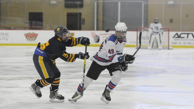 Lenawee United's Caden Henline looks to make a play on the puck during a game against Whitmer in the 2019-20 season.