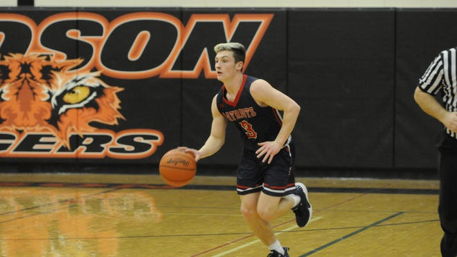 Britton Deerfield's Nico Johnson moves the ball up the floor during a nonconference game at Hudson on Jan. 28, 2020.
