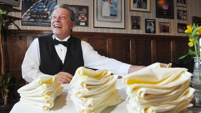 Rick Massey of Cocoa who's been a waiter at Yen Yen restaurant in Cocoa Beach for the last 19 years helps fold napkins before his shift. Rick has met astronauts, politicians and celebrities.