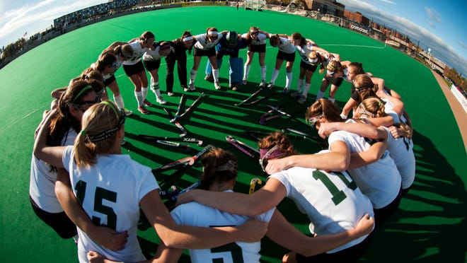 Rice huddles together before the start of the girls high school semi final field hockey game between the Harwood Highlanders and the Rice Green knights at Moulton/Winder field on Monday afternoon October 27, 2014 in Burlington, Vermont.(BRIAN JENKINS, for the Free Press)