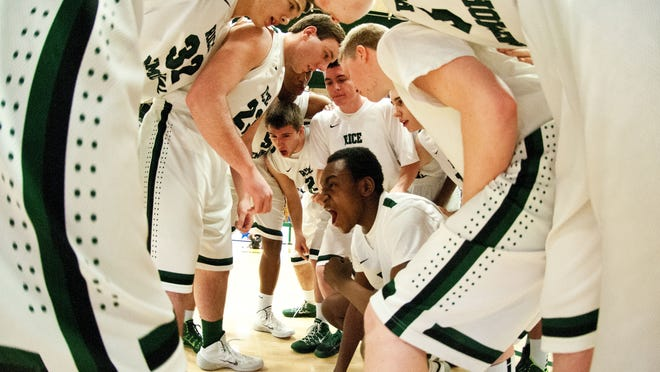 Rice huddles together before the opening tip off during the 2014 Division I boys basketball championship game against Mount Mansfield at Patrick Gymnasium.