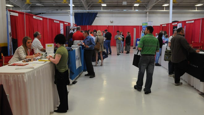 Job seekers talk with businesses at the Fox Valley Career Fair where more than 100 businesses attended the 2014 event at Sunnyview Expo Center.