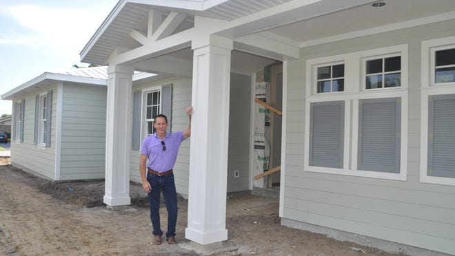 Gary Aubuchon stands in the doorway of the first display home in his new Sterling Collection. The home in Fort Myers is part of his effort to be known as a regional builder.